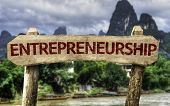 pic of entrepreneurship  - Entrepreneurship wooden sign with a agricultural background - JPG