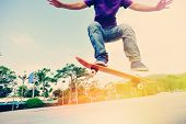 foto of skateboarding  - young asian woman skateboarder skateboarding at city - JPG