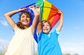 picture of kites  - Little girl and little boy playing kite together - JPG