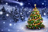 picture of fir  - Magnificent colorful Christmas tree outdoor in a snowy night with a shooting star in the sky for the perfect Christmas mood - JPG