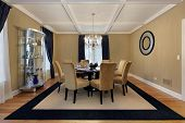 pic of light fixture  - Dining room with tan walls and blue drapes - JPG