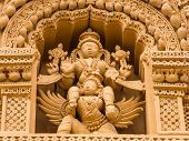 pic of garuda  - A carving of Vishnu riding his vehicle Garuda on the roof of the temple of Srikathesvara at Nanjangud - JPG