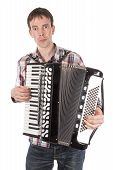 image of accordion  - Man playing at an accordion isolated over white - JPG