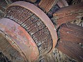 stock photo of wagon wheel  - close up of antique and weathered wooden wagon wheel - JPG