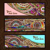 stock photo of wood design  - Set of three abstract doodle ethnic tribal hand drawn vector cards on wood background - JPG
