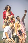 stock photo of mans-best-friend  - Group of multiracial happy friends taking a selfie  - JPG