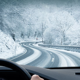 pic of slippery-roads  - Curvy snowy country road leading through a mountain landscape - JPG