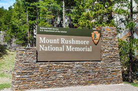 image of mount rushmore national memorial  - Mount Rushmore monument sign in South Dakota in the morning - JPG