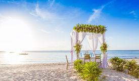 foto of cabana  - wedding arch and set up on beach - JPG