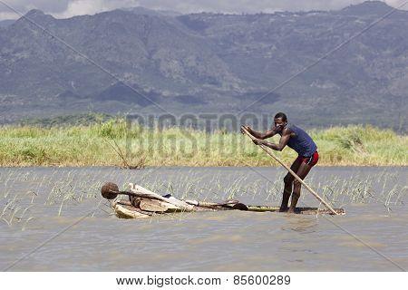Man In A Salfemade Boat