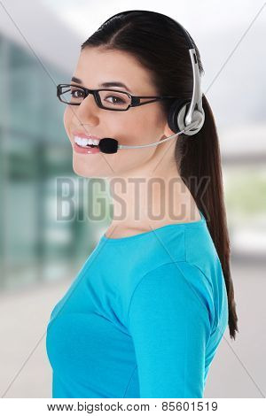 Casual woman with microphone and headphones