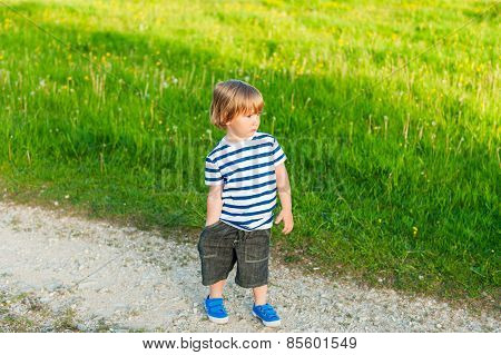 Cute toddler boy outdoors on sunset