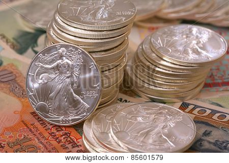 International currency and walking libery silver