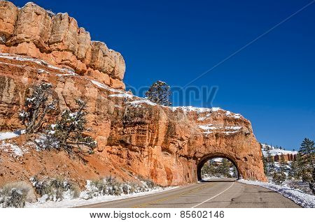 Red Canyon Tunnel with Icicles Hanging from the Arch