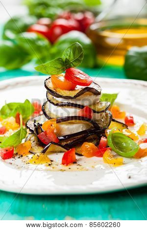 Eggplant, Tomato and Mozzarella Stacks on plate