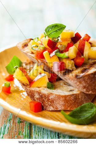 Bruschetta with Peach Salsa on the plate