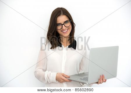 Happy young businesswoman standing with laptop, vignette