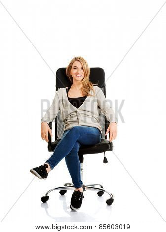 Young woman sitting on armchair.