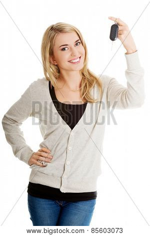 Happy woman holding a car key.