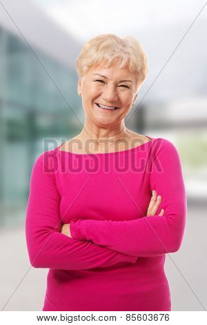 Old lady's portrait in pink casual clothes