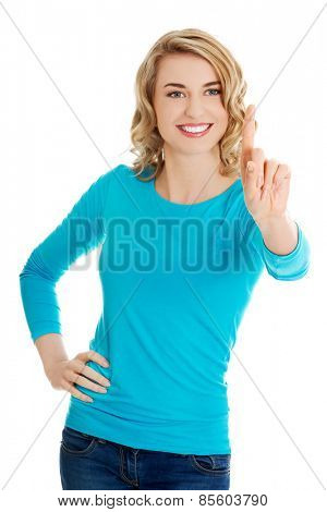 Front view woman pushing imaginary button.