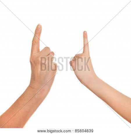 Adult's hand and child's hand with finger point up. Idea, attention concept.