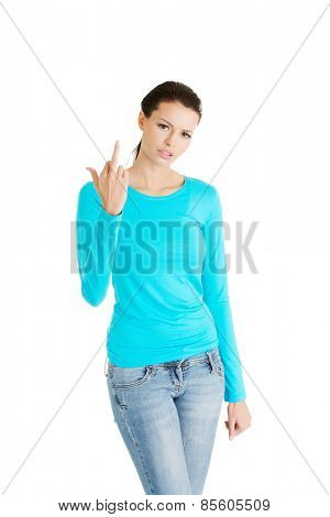Young woman showing middle finger.