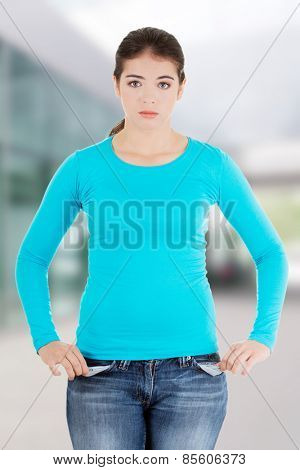 Front view of a sad young female caucasian teen.
