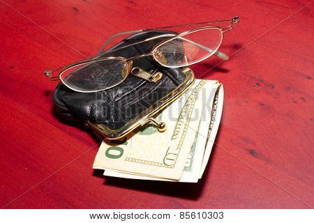 purse, glasses,dollars