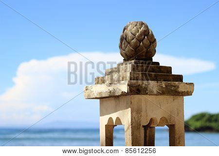 stone pillar at the sea