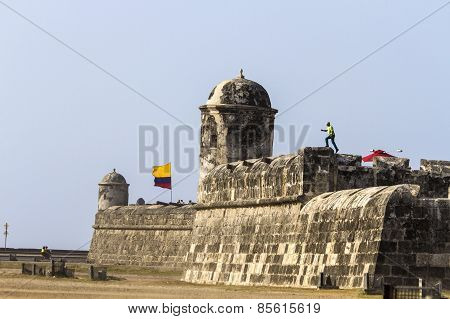 Man Walking In Ancient Military Walls