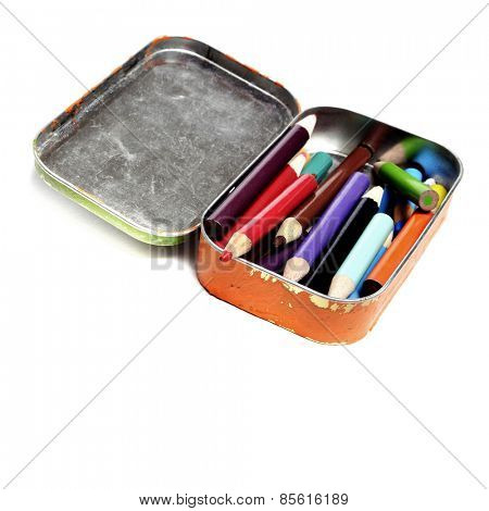 Tin bin of colored pencils representing creative art artistic creation
