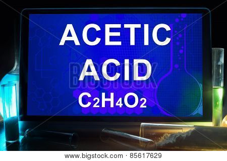 Tablet with chemical formula of  acetic acid.