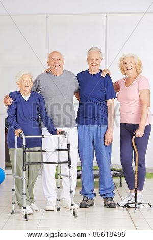 Old men and senior women standing together in a nursing home