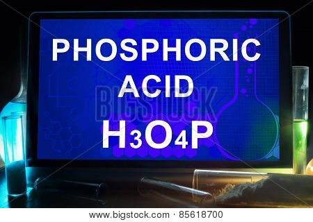 Tablet with chemical formula of phosphoric acid.