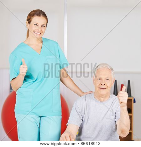 Physiotherapist and patient holding thumbs up in a nursing home