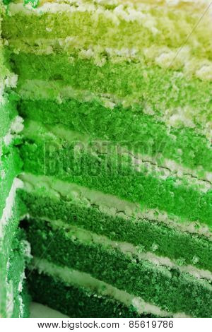 Light green cut cake for Saint Patrick's Day, macro view