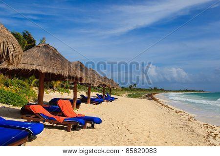 Beach chairs on exotic tropical sand beach