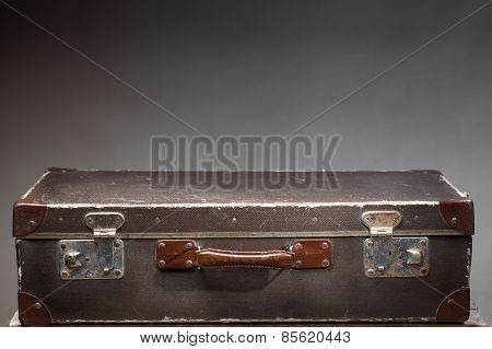 Old Vintage Suitcase On Wooden Table