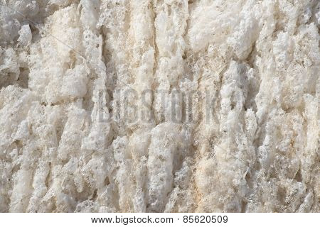 beige background frozen river foam