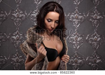 Sexy Brunette Woman At Black Lingerie Posing On Vintage Wall