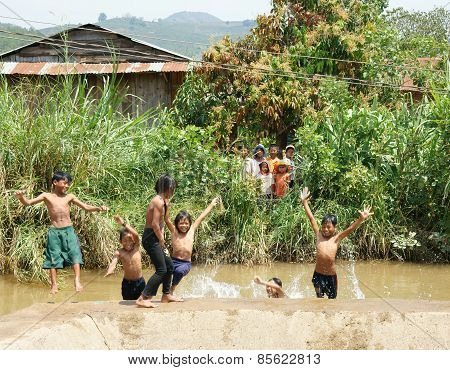 Asian Children Bath In The River