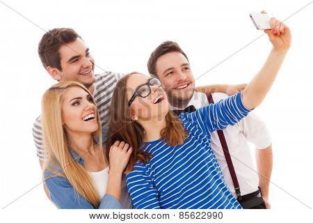 Four stylish young people maing a selfie