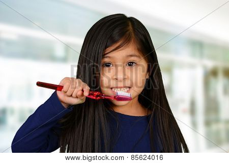 Young child who is brushing their teeth