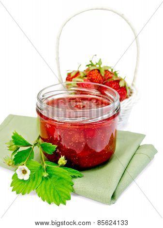 Jam strawberry with basket of berry on napkin