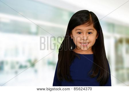 Young girl at school who is smiling
