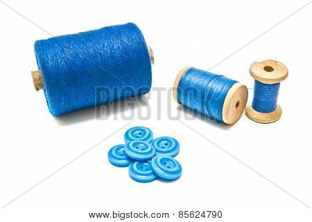 Spools Of Thread And Blue Buttons
