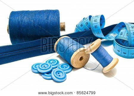 Blue Buttons, Zipper And Spools Of Thread