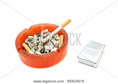 Cigarette In Ashtray And Silver Lighter