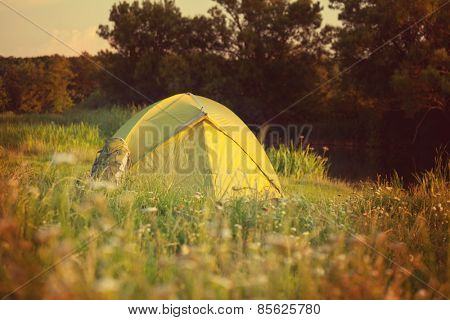 tent on green grassland